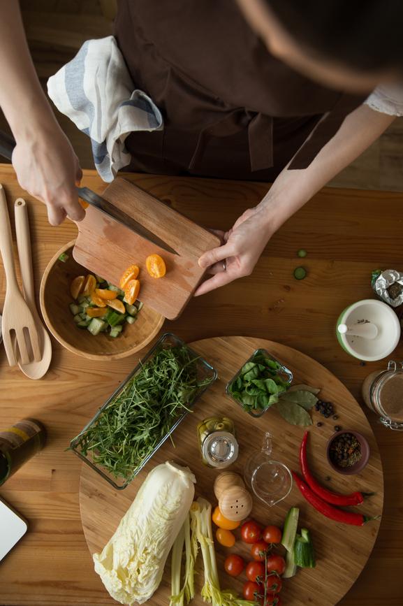 hands cooking salad