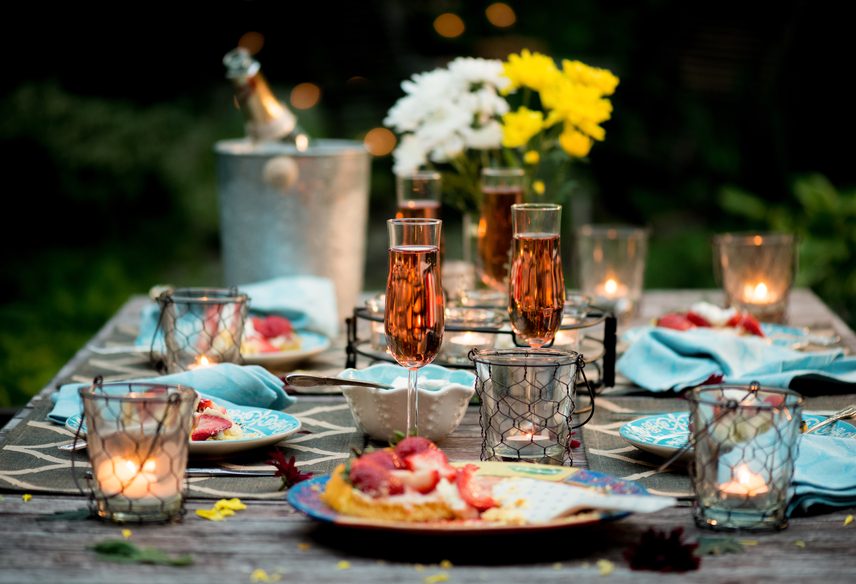 Table Set For Outdoor Dining With Dessert Course Of Strawberry Flan With  Creme Fraiche And Pink