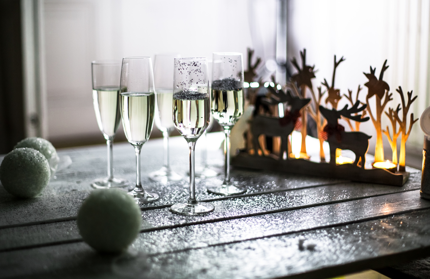Champagne flutes and Christmas decoration.
