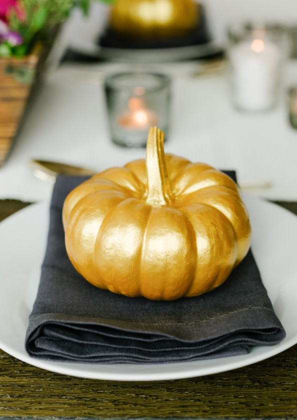 Golden pumpkin or squash on plate