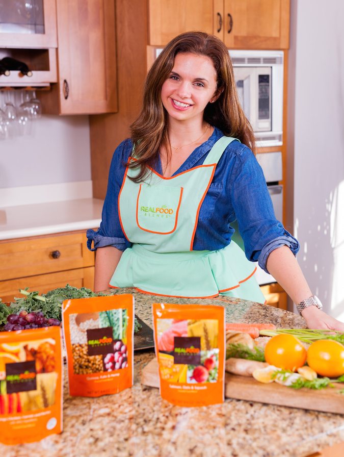 RFB Photo Shoot Julie in green apron with meals & ingredients_112615 (1)